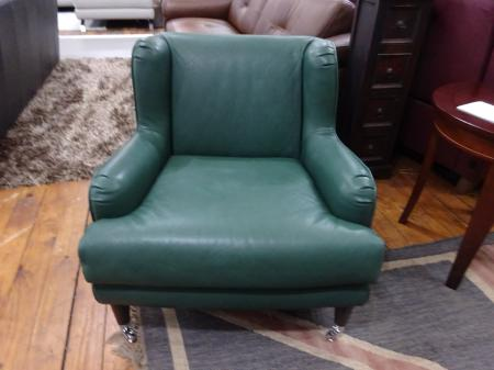 Natuzzi Italia Natalie Statement chair in thick forest green leather